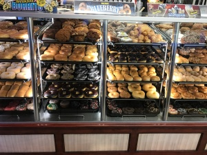 I would have to take three pictures to catch the whole row of donuts.
