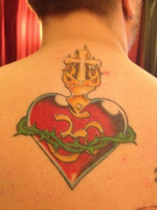 Part of my back tattoo, sacred heart with an Ohm symbol